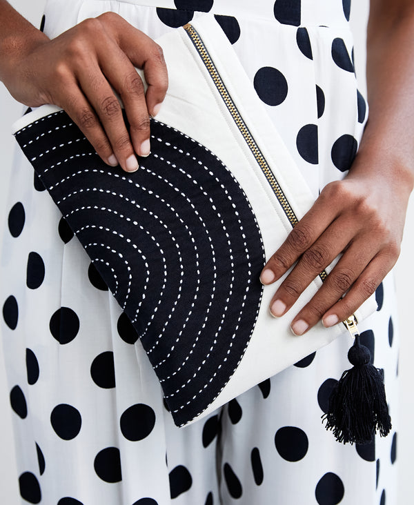 Black and white small clutch featuring traditional Kantha stitching made from Anchal artisans