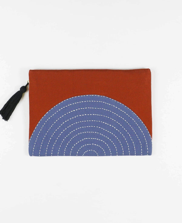 organic cotton rust orange and slate blue clutch with tassel zipper pull