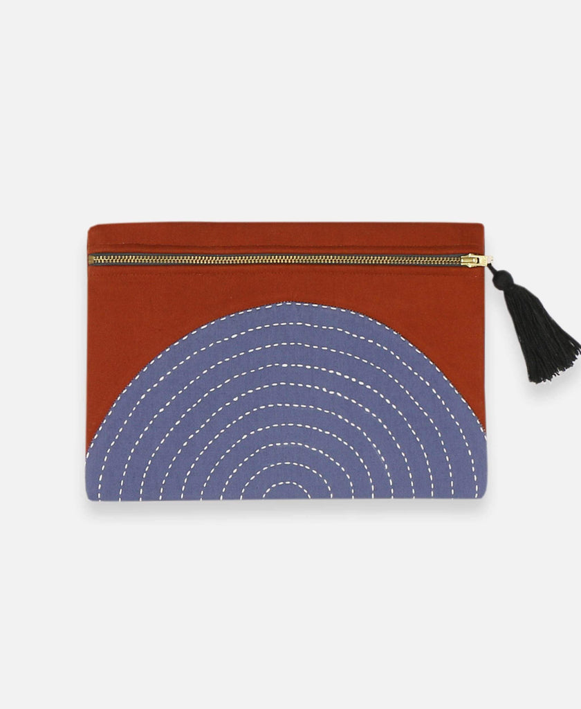 Anchal Project organic cotton canvas pouch with rust orange eclipse pattern