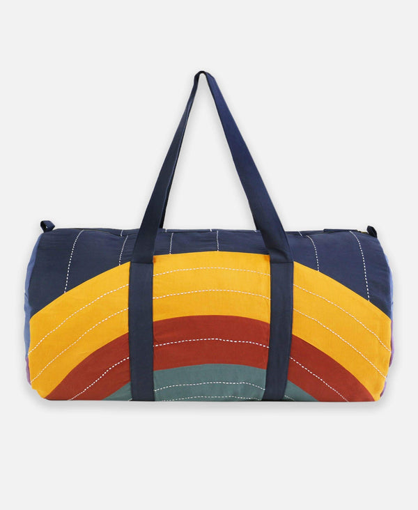Anchal Project organic cotton travel duffle bag with rainbow eclipse pattern