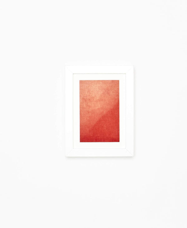 red gradient textile art in modern white frame