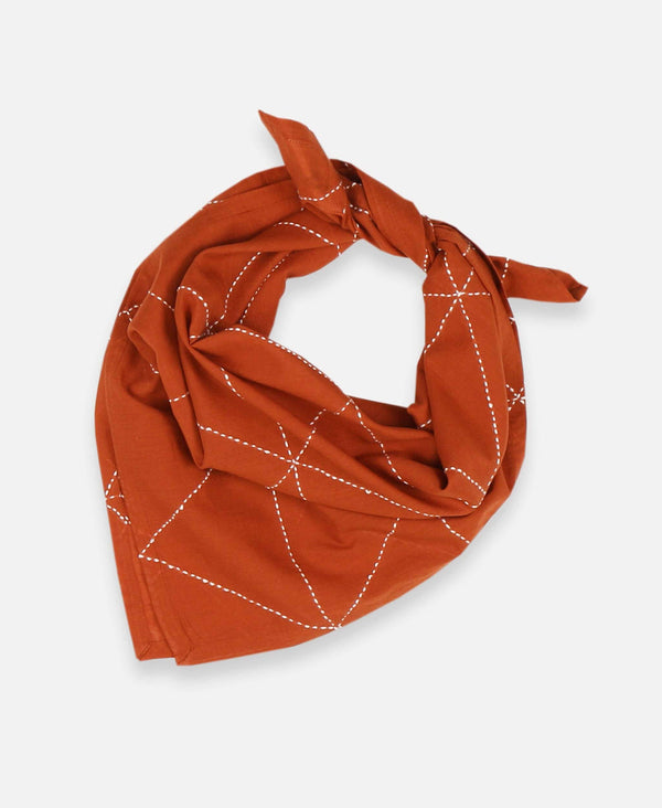 Anchal Project organic cotton bandana scarf with hand-stitched geometric pattern in rust orange