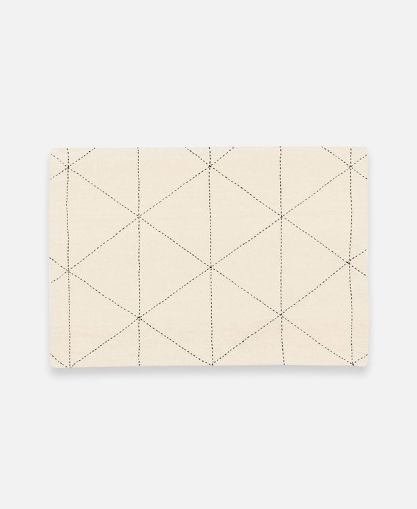 ivory placemat set with graph design made from organic cotton and hand-stitched by Anchal Project artisans