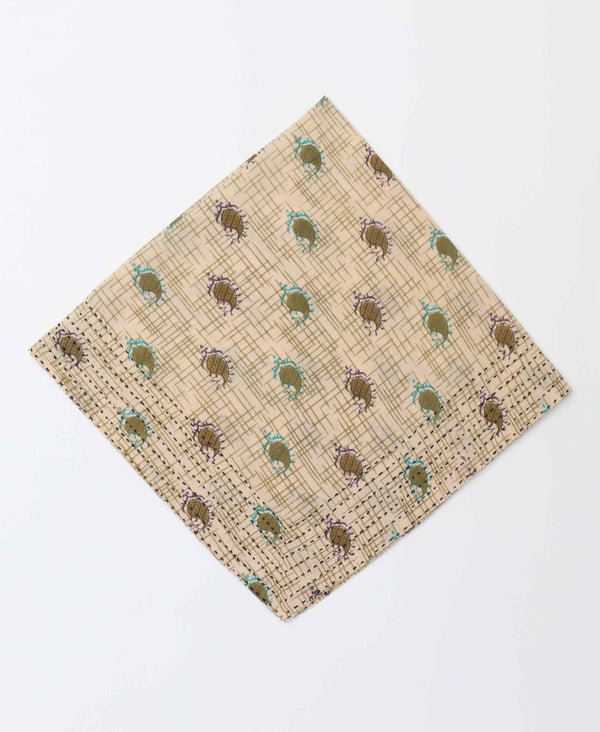 Light brown bandana featuring blue and lilac paisley patterns with a bold blue kantha stitch