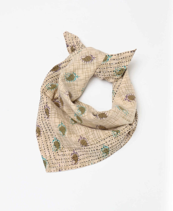 Beige and green grid neck scarf with accents of blue and purple patterns showcased on organic cotton materials