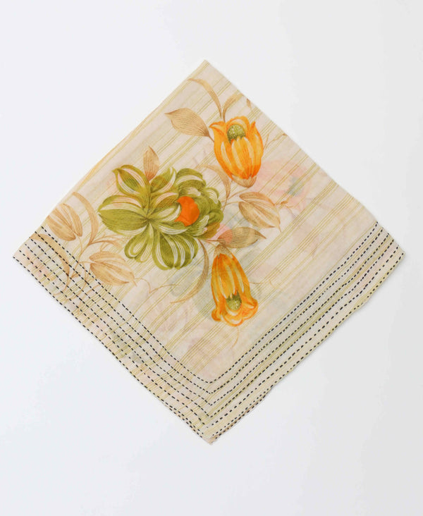 Handcrafted bandana featuring light spring colors and a bold floral pattern