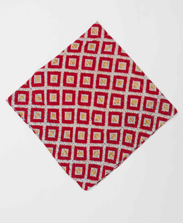 Bold geometric printed bandana with white stitching and gold accents