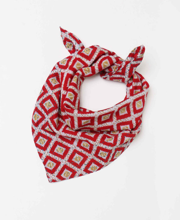 Patterned neck scarf with bold red coloring to create a statement and one of a kind look