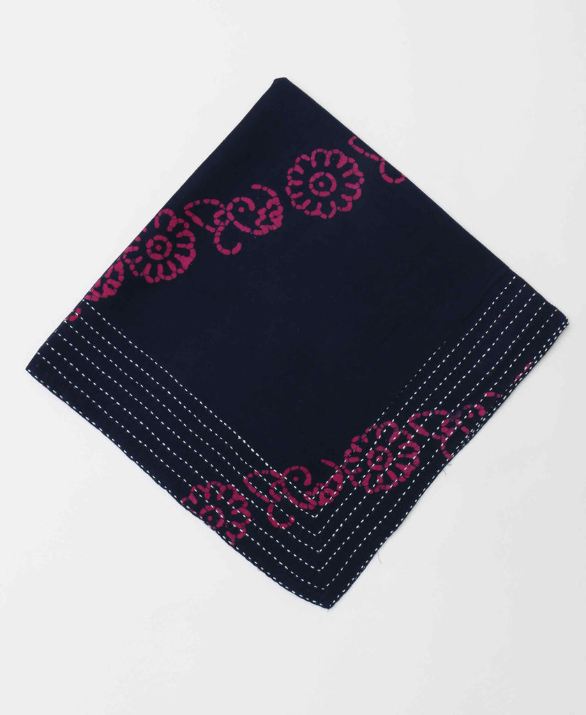Deep navy colored bandana with a contrasting fuschia paisley stripe