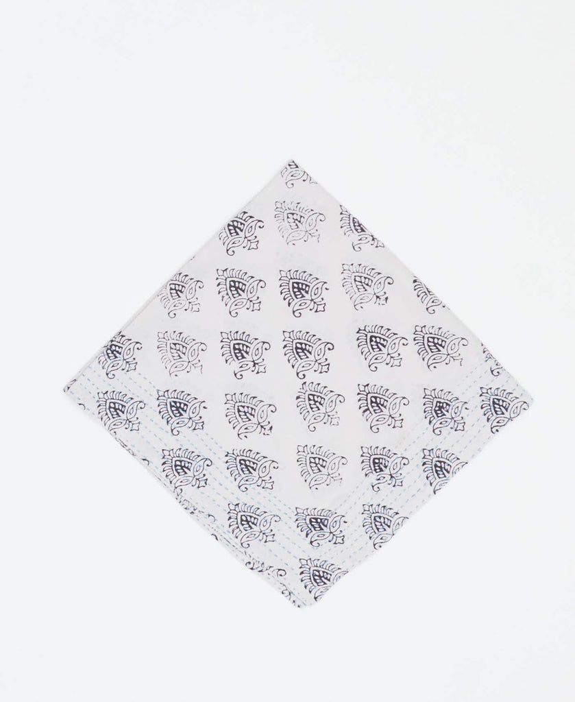 White vintage kantha bandana handmade by Anchal artisans with black paisley prints and blue kantha stitching