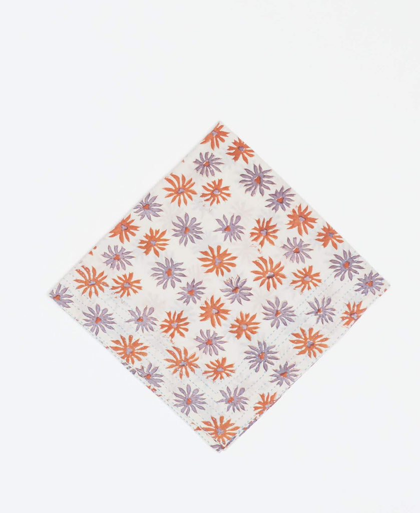 White vintage kantha bandana handmade by Anchal artisans with orange and purple floral prints and light blue kantha stitching