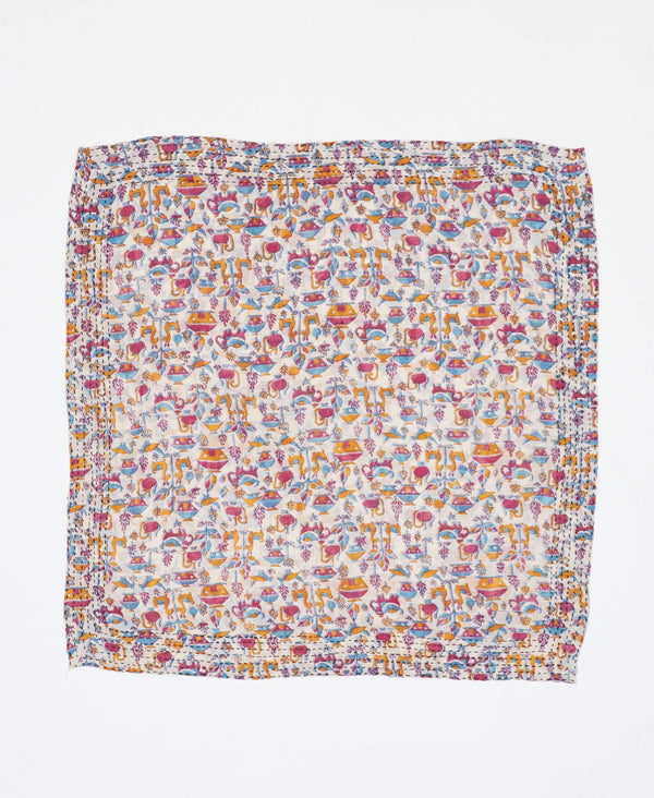 Fair trade white bandana with pink, blue, and yellow designs handstitched by Anchal artisans in Ajmer India