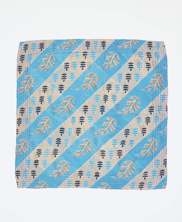 Fair trade blue and white bandana with black and yellow designs handstitched by Anchal artisans in Ajmer India