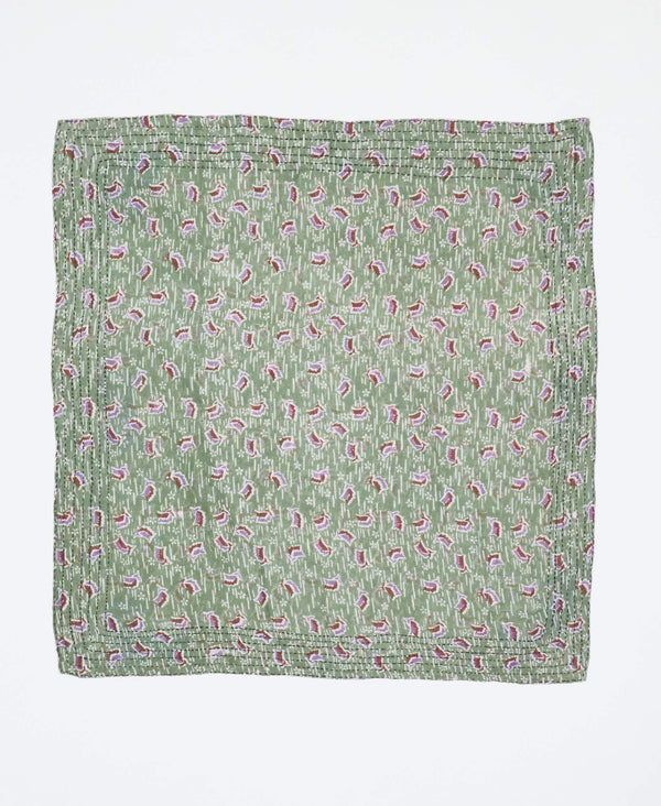 Fair trade green bandana with small red and purple designs handstitched by Anchal artisans in Ajmer India