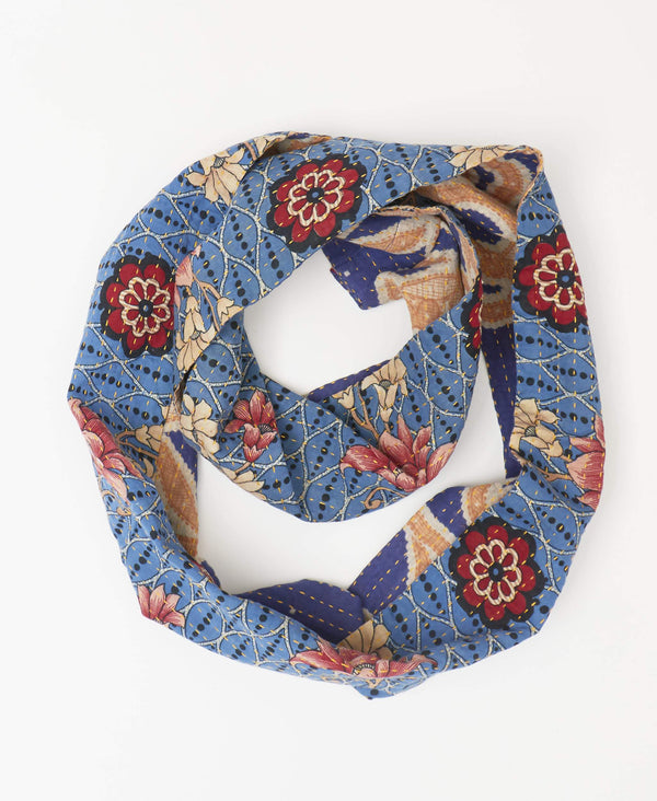 Blue infinity Kantha scarf with geometric pattern and pink and red flowers made from recycled cotton sarees