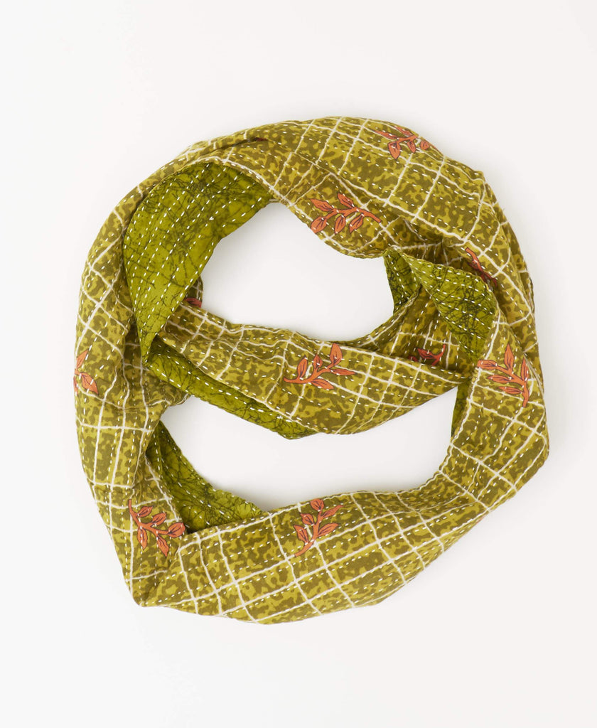 Anchal fairtrade green infinity scarf with a white grid and orange plant print made from a reused saree