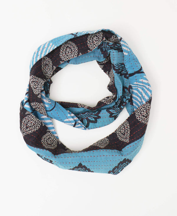Anchal deep blue fairtrade reversible infinity scarf with white stripes and navy paisley patterns stitched with a red kantha stitch