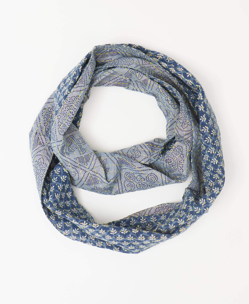 Fairtrade blue reversible infinity scarf with geometric and floral printing created with small lines simulating a mosaic design