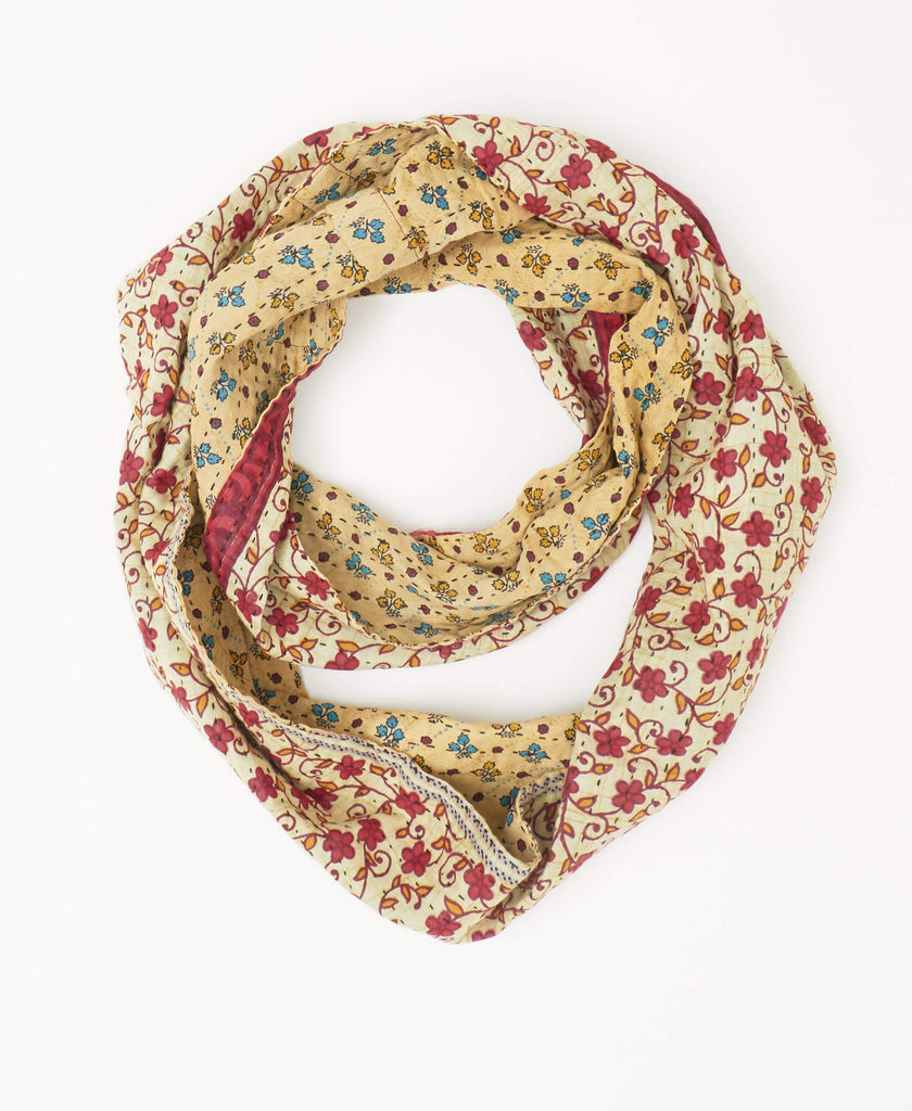 Red and off-white reversible Kantha infinity scarf with blue and yellow floral details made from recycled sarees