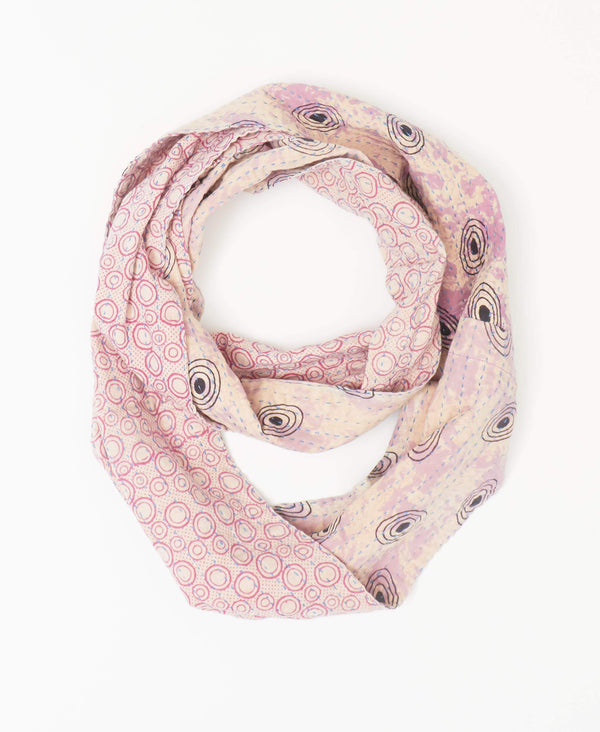 Anchal light purple reversible kantha infinity scarf with black circler patterning on one side and pink patterning on the reverse