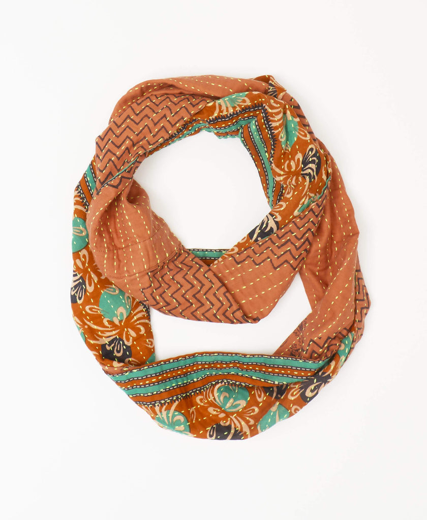 Orange fairtrade vintage Kantha infinity scarf with black zig-zag patterning on one side and black and green spots on the reverse