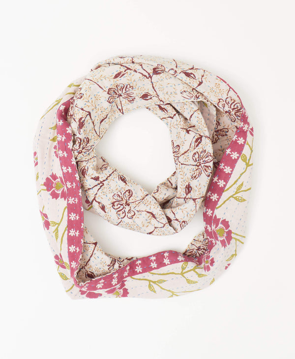 White reversible infinity scarf made from recycled sarees with pink flowers and green stems on one side and a dark red floral pattern on the other