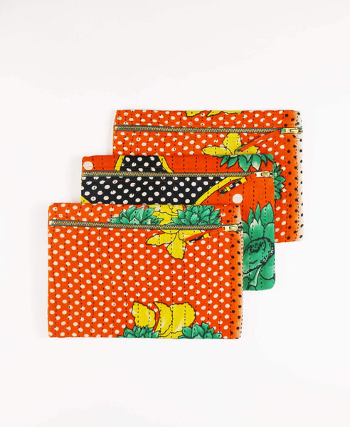 Fair Trade orange canvas clutch made from upcycled vintage cotton saris patterned in polka dots