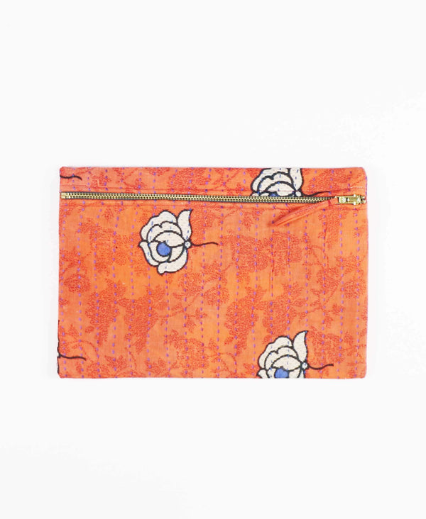 peach cotton clutch with white and blue floral pattern