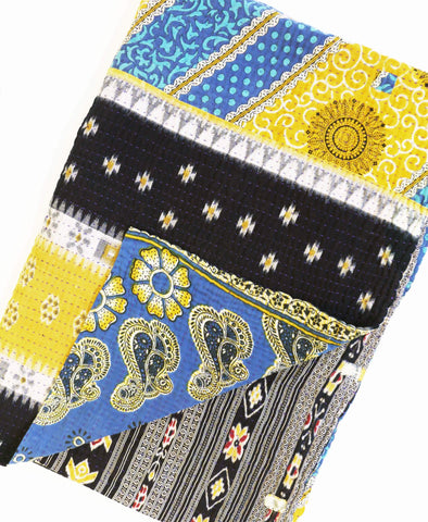 Blue and yellow kantha quilt with red and black patterning handmade by Anchal Project artisans