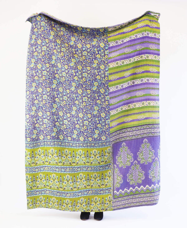 Purple and green floral Anhcal Project kantha quilt with stiped patterns made from recycled saris