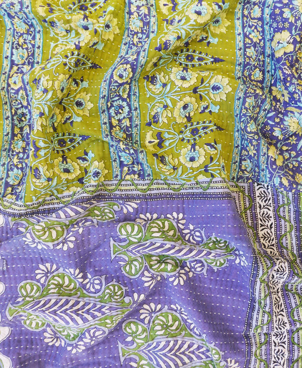 Sustainable vintage sari throw with purple and green floral designs and a white kantha stitch