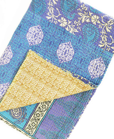 Sustainable blue and gold throw made from recycled saris with a yellow kantha stitch