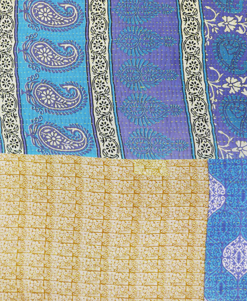 Blue and gold paisley and ogee patterned quilt with a yellow kantha stitch