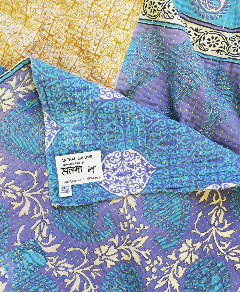 Fair Trade blue and gold paisley quilt handmade by Anchal Project artisans in India