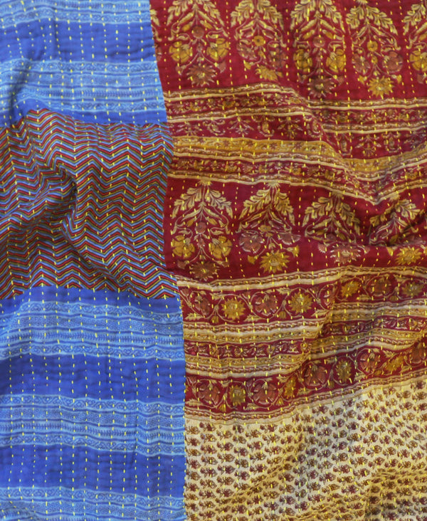 Anchal Project vintage cotton kantha quilt with red and gold floral and blue and red geometric patterns
