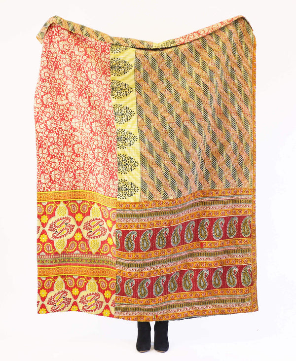 red and brown kantha quilt made from layers of vintage cotton fabrics