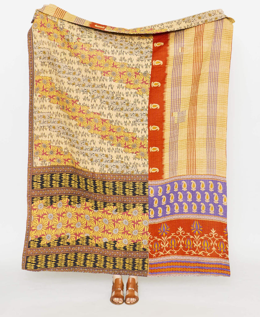 multicolored quilt throw using upcycled vintage saris to create and orange and red quilt throw