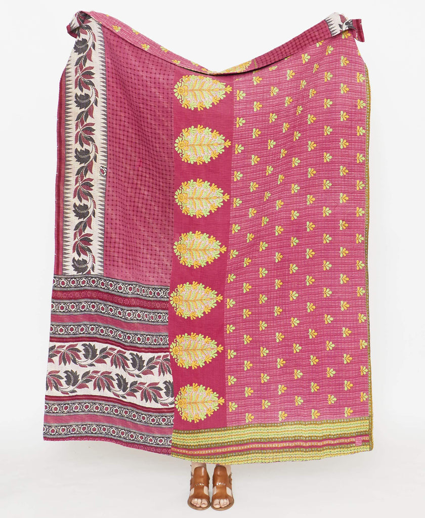 Magenta quilt throw that is sustainably handmade in Ajmer, India using vintage saris