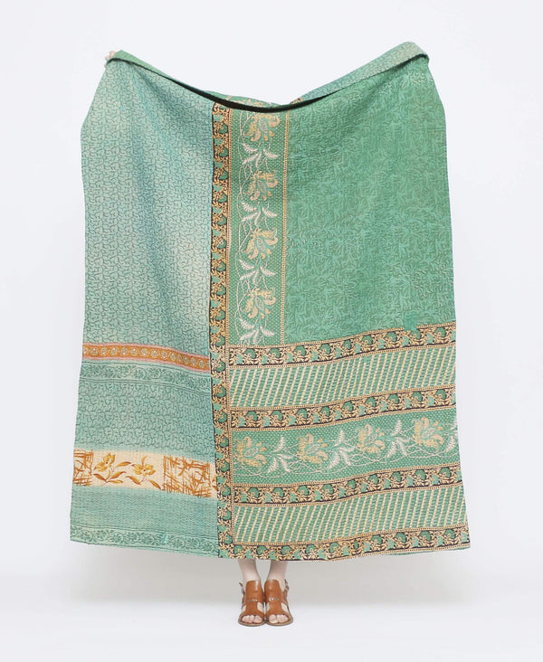 Blue and mint vintage throw quilt with gold detailing and floral patterns and XX kantha stitching