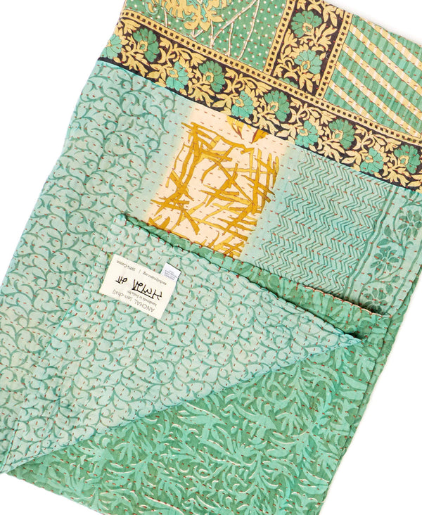 Fair trade mint green and blue throw quilt handstitched by Anchal artisans in Ajmer India with small floral and leaf designs