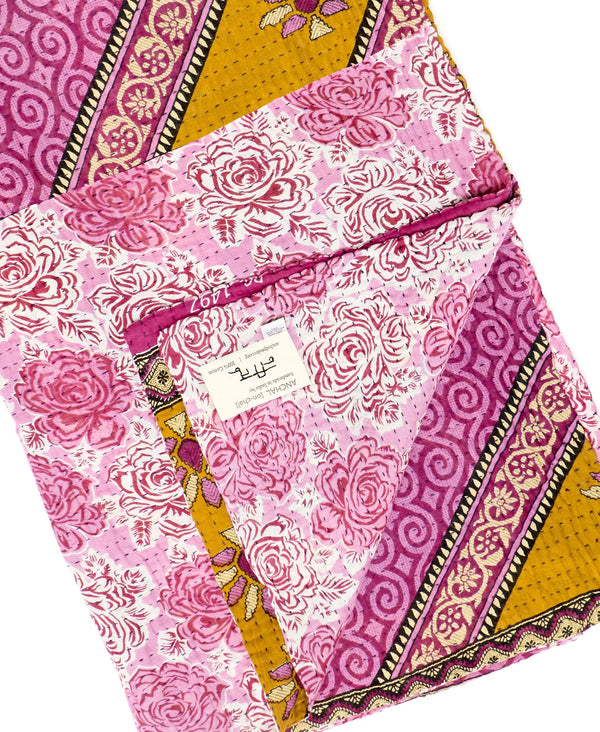 Fair trade purple throw quilt handstitched by Anchal artisans in Ajmer India with bold floral and paisley designs