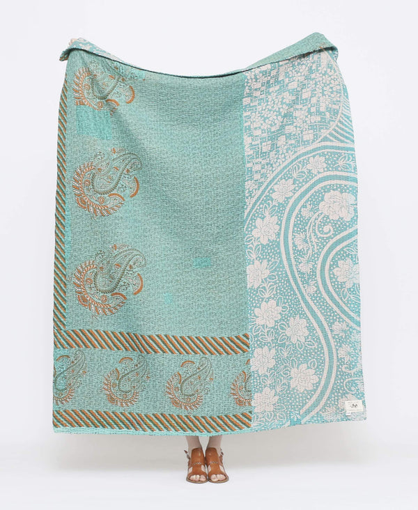 Blue vintage throw quilt with yellow detailing and large paisley prints with black kantha stitching