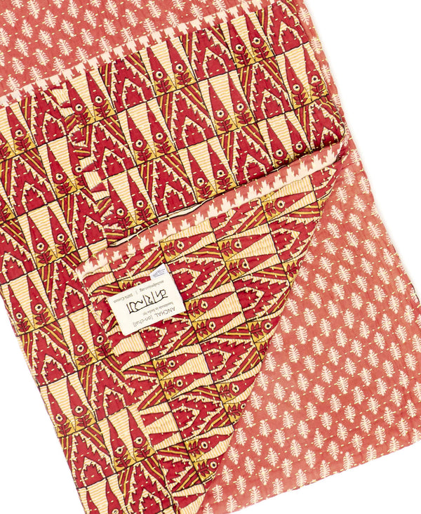 Fair trade red kantha throw quilt handmade by Anchal artisans in Ajmer India with geometric and paisley designs