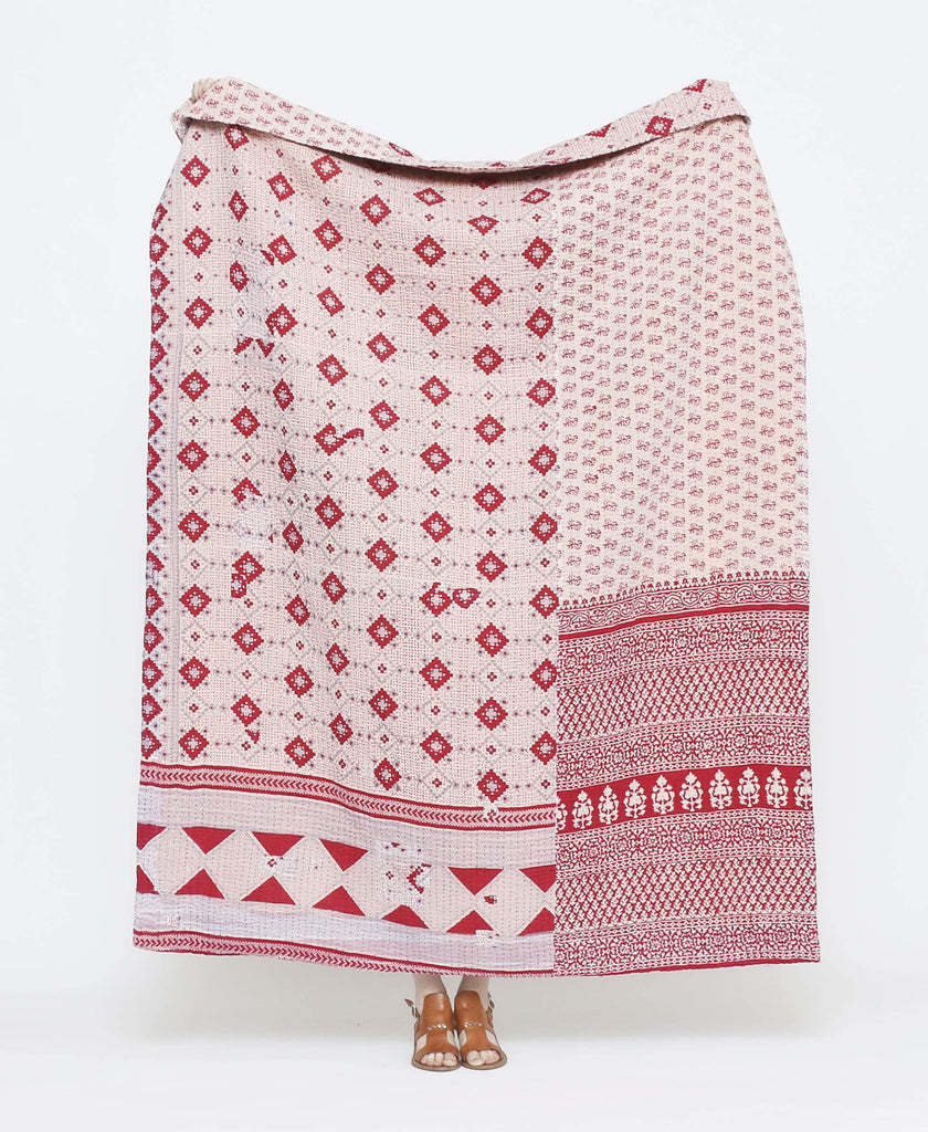 Red and white vintage throw quilt with geometric shapes with red kantha stitching