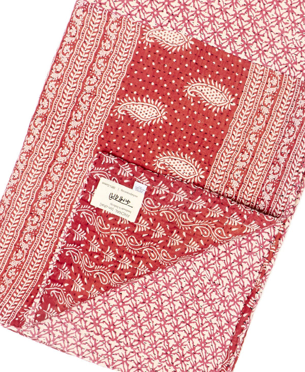 Fair trade red kantha throw quilt handstitched by Anchal artisans in Ajmer India with small paisley and geometric designs