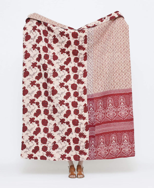 Dark red and white vintage throw quilt with large rose floral prints with purple kantha stitching