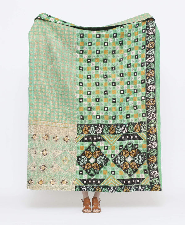 Mint green and yellow vintage throw quilt with white detailing and geometric and paisley prints with white kantha stitching