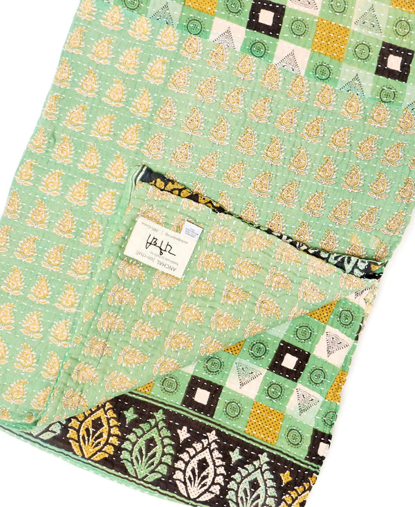 Fair trade mint green throw quilt handstitched by Anchal artisans in Ajmer India with paisley and geometric designs