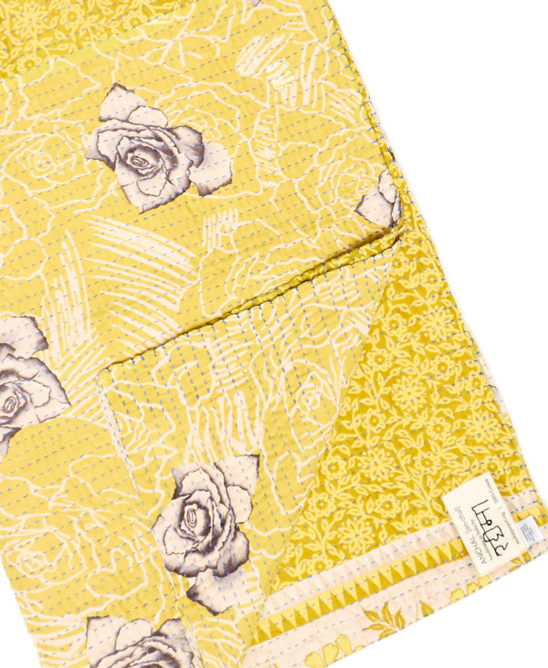Fair trade yellow throw quilt handstitched by Anchal artisans in Ajmer India with large floral designs