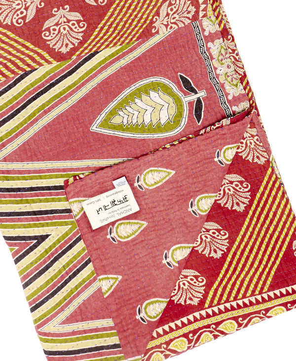 Fair trade red and orange throw quilt handstitched by Anchal artisans in Ajmer India with paisley and striped designs
